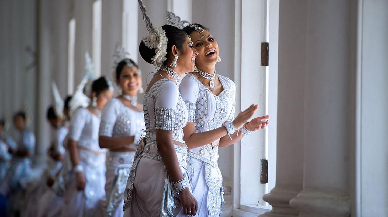 "<a href=""https://www.flickr.com/photos/9364837@N06/16720359423"" target=""_blank"" rel=""noopener noreferrer"">Traditional Sri Lankan dancers | U.S. Department of State / Flickr</a>"