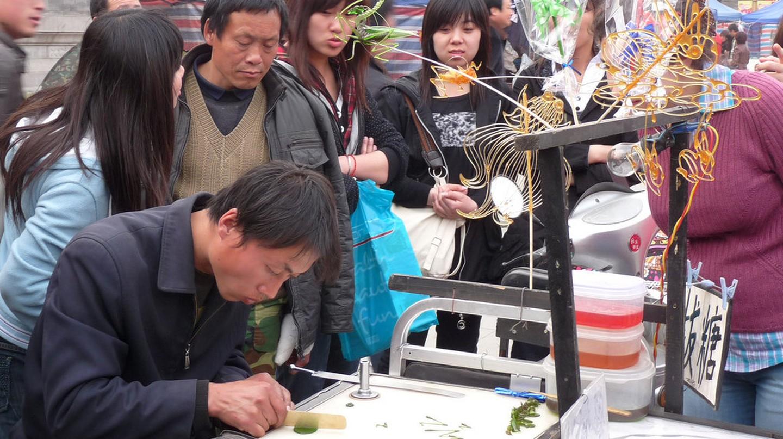 """<a href=""""https://www.flickr.com/photos/santangelo-jon/4527606399""""> Tianjin People © Jon Santangelo/Flickr</a>"""