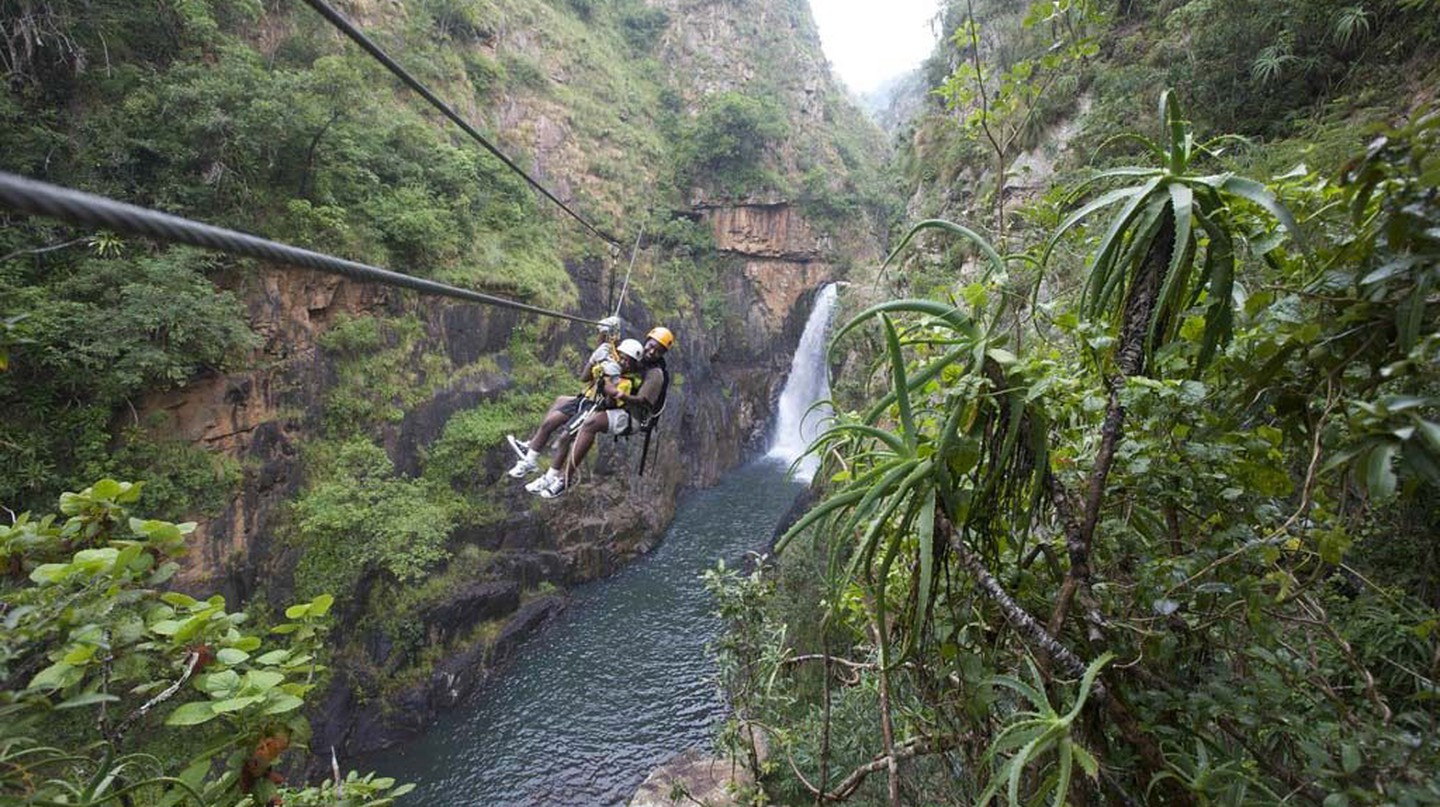 Keep a lookout for the variety of wildflowers and orchids adorning the cliffs | Courtesy of Canopy Tours