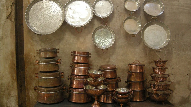 Copper pots in Yazd's Khan Bazaar   © Pontia Fallahi