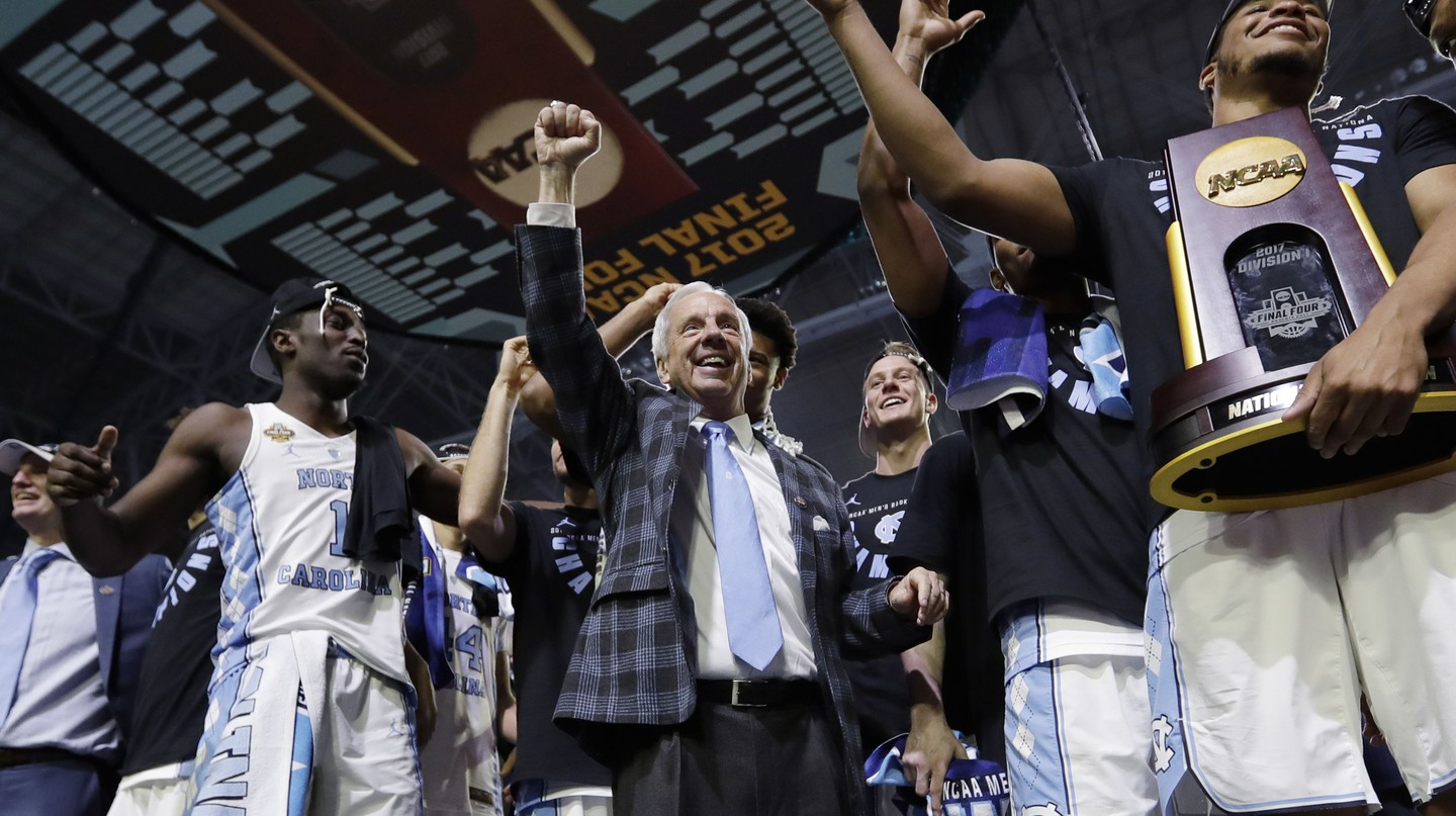 UNC coach Roy Williams and players celebrating winning the 2017 NCAA Tournament © AP/REX/Shutterstock