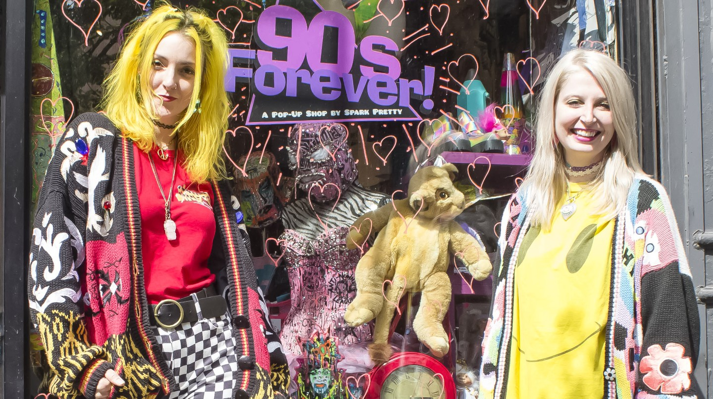 Amanda Dolan and Meagan Colby pose in front of their Spark Pretty '90s pop up shop