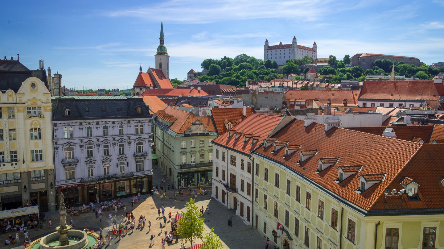 Bratislava's beautiful central square with a view of the castle on the hill above it | © RobHurson/Flickr