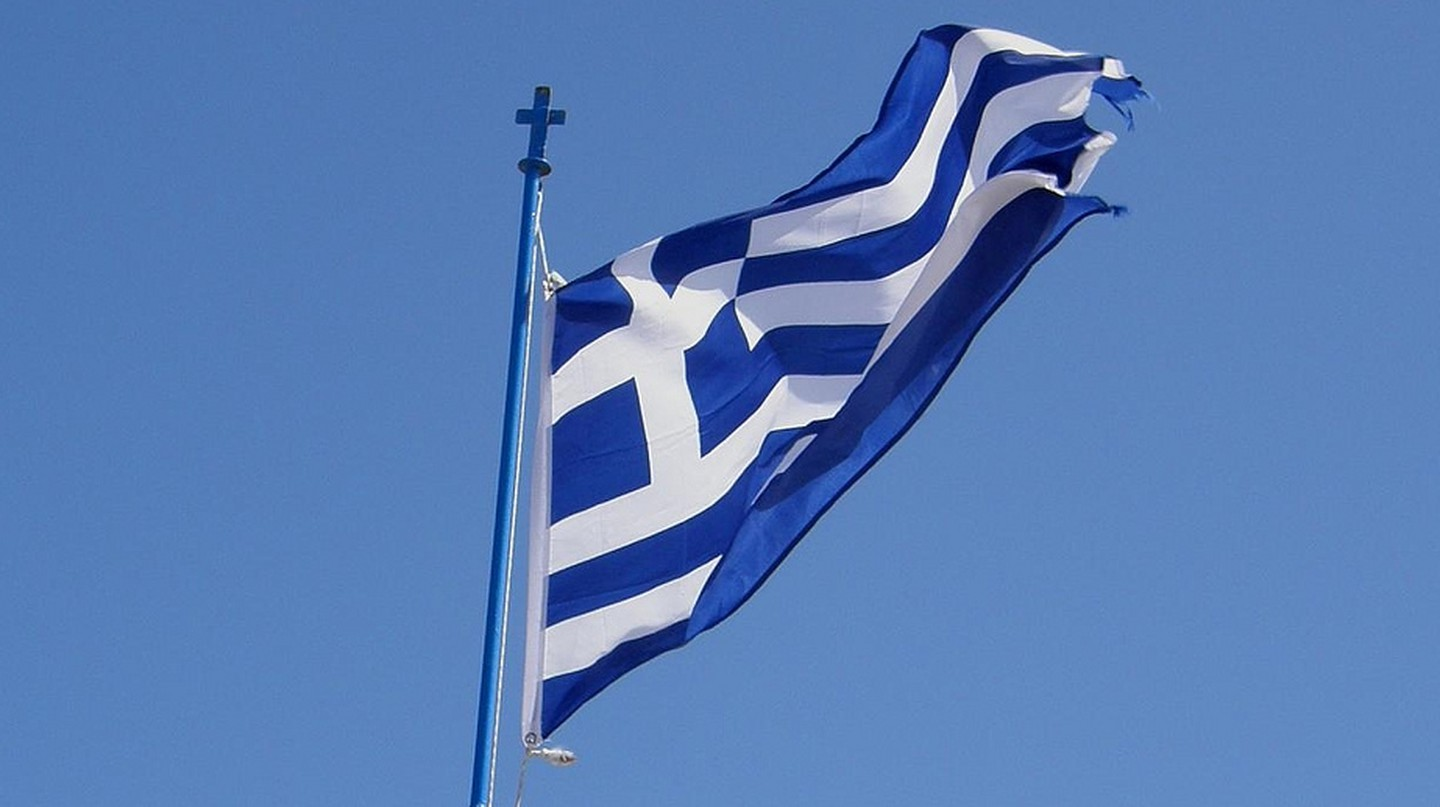 "<a href=""https://www.flickr.com/photos/klearchos/5068123297"" target=""_blank"" rel=""noopener noreferrer"">Flag of Greece 