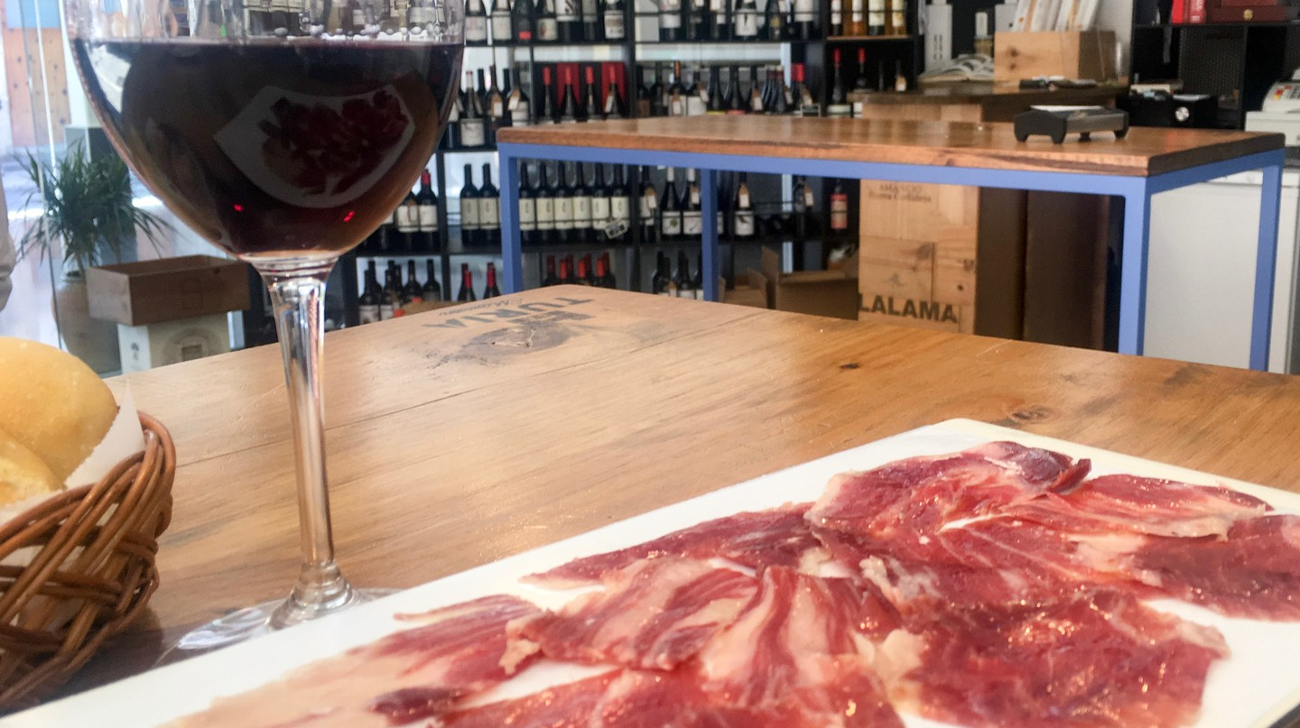 Try authentic local red wines and jamón on a Valencian food tour. | Photo courtesy of Delicious Valencia Food Tours