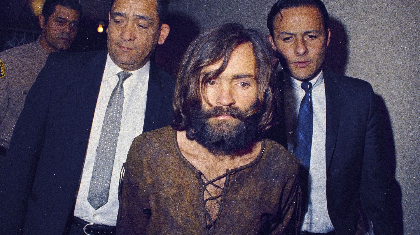 Police escorting Charles Manson | © Photo by Anonymous/AP/REX/Shutterstock