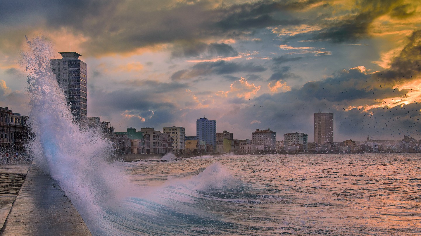 Waves crash against El Malecon in Havana
