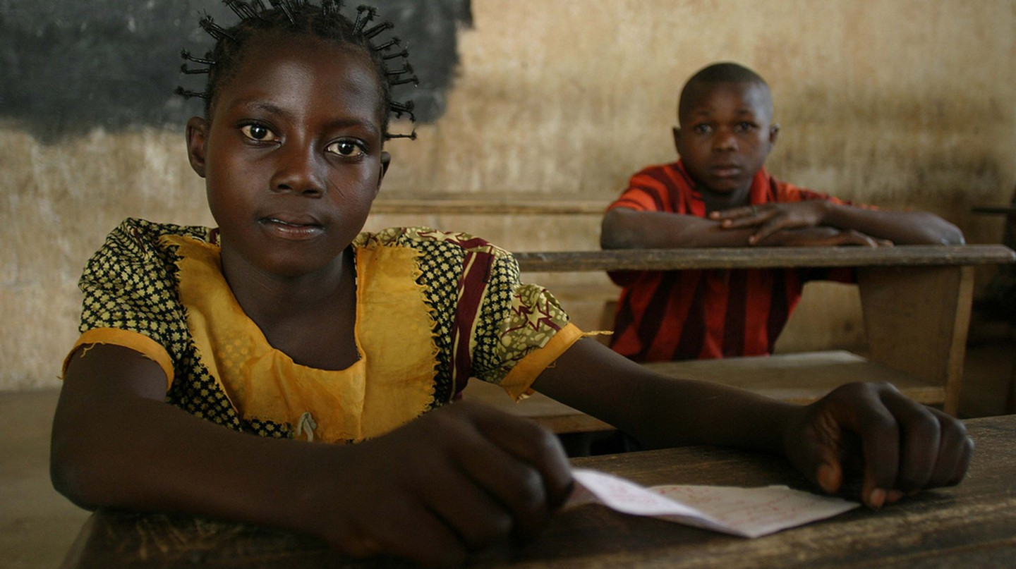 Young girl and boy attending school   © hdptcar/Flickr