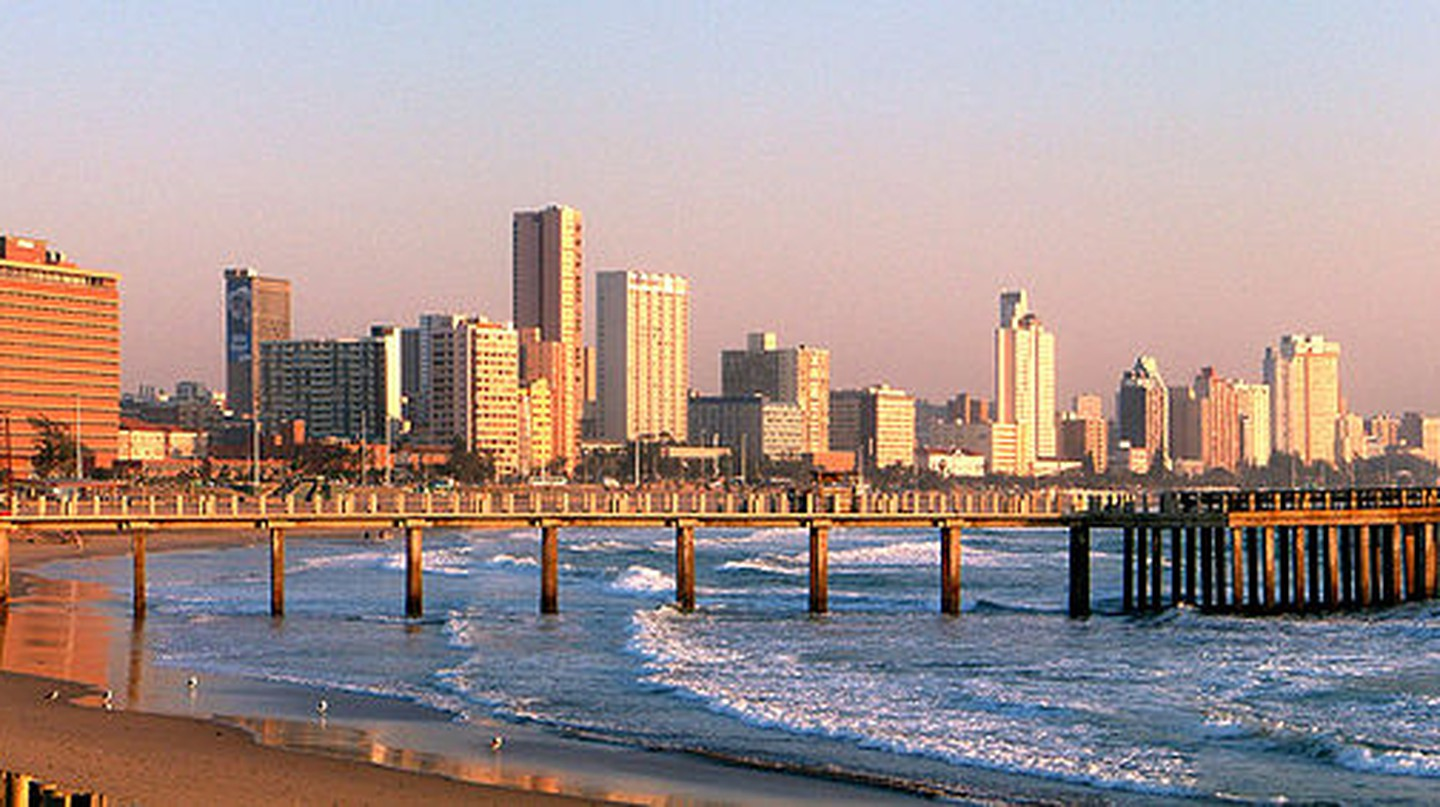 """<a href=""""https://commons.wikimedia.org/wiki/File:Durban_skyline.jpg"""">Durban's beaches are dotted with piers 