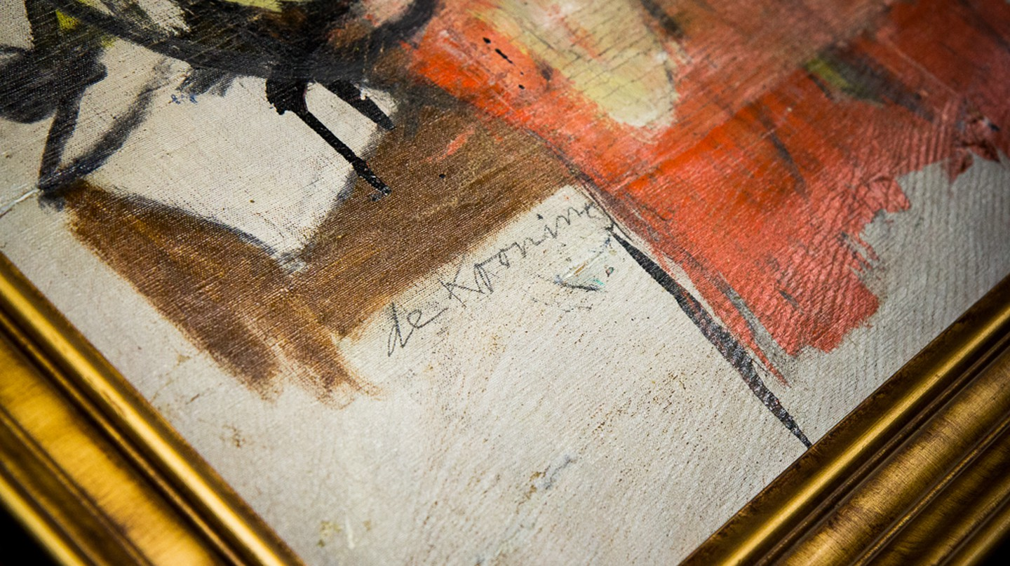 Willem de Kooning's signature on the recovered Woman-Ochre (1954-1955) (detail) | Courtesy of the University of Arizona Museum of Art