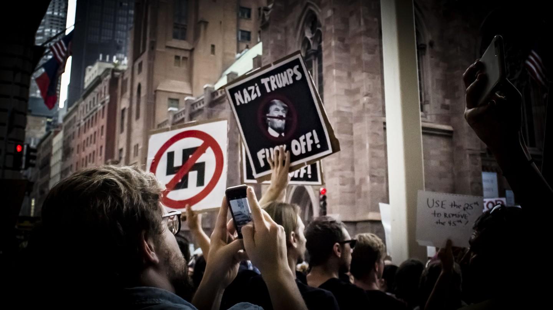 Anti-Nazi signs at a protest at Trump Tower, New York | © Amanda Suarez/ Culture Trip