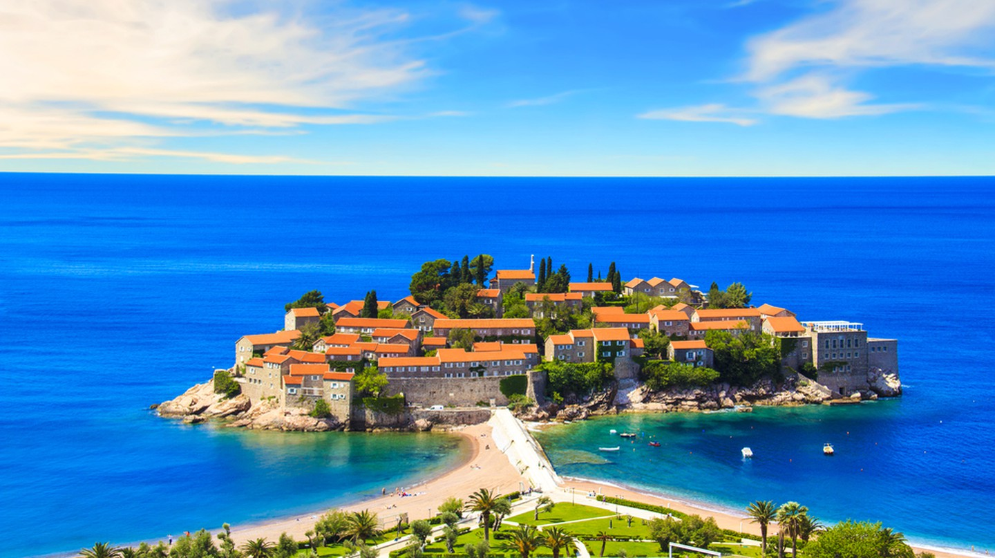Beautiful view of the island-resort of St. Stefan (Sveti Stefan) on the Budva Riviera, Budva, Montenegro on a sunny day