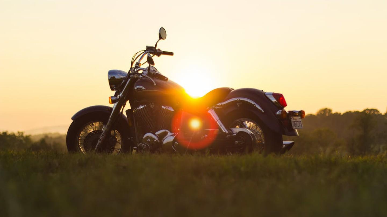 "<a href="" https://www.pexels.com/photo/sunset-motorcycle-motorbike-roadtrip-9090/""> Motorbike | © Tookapic / Pexels</a>"