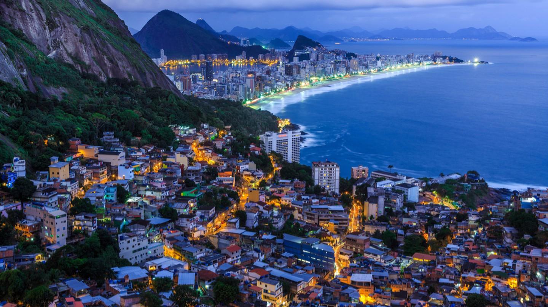 Vidigal favela and the Copacabana illuminated at night   © Hethers/Shutterstock