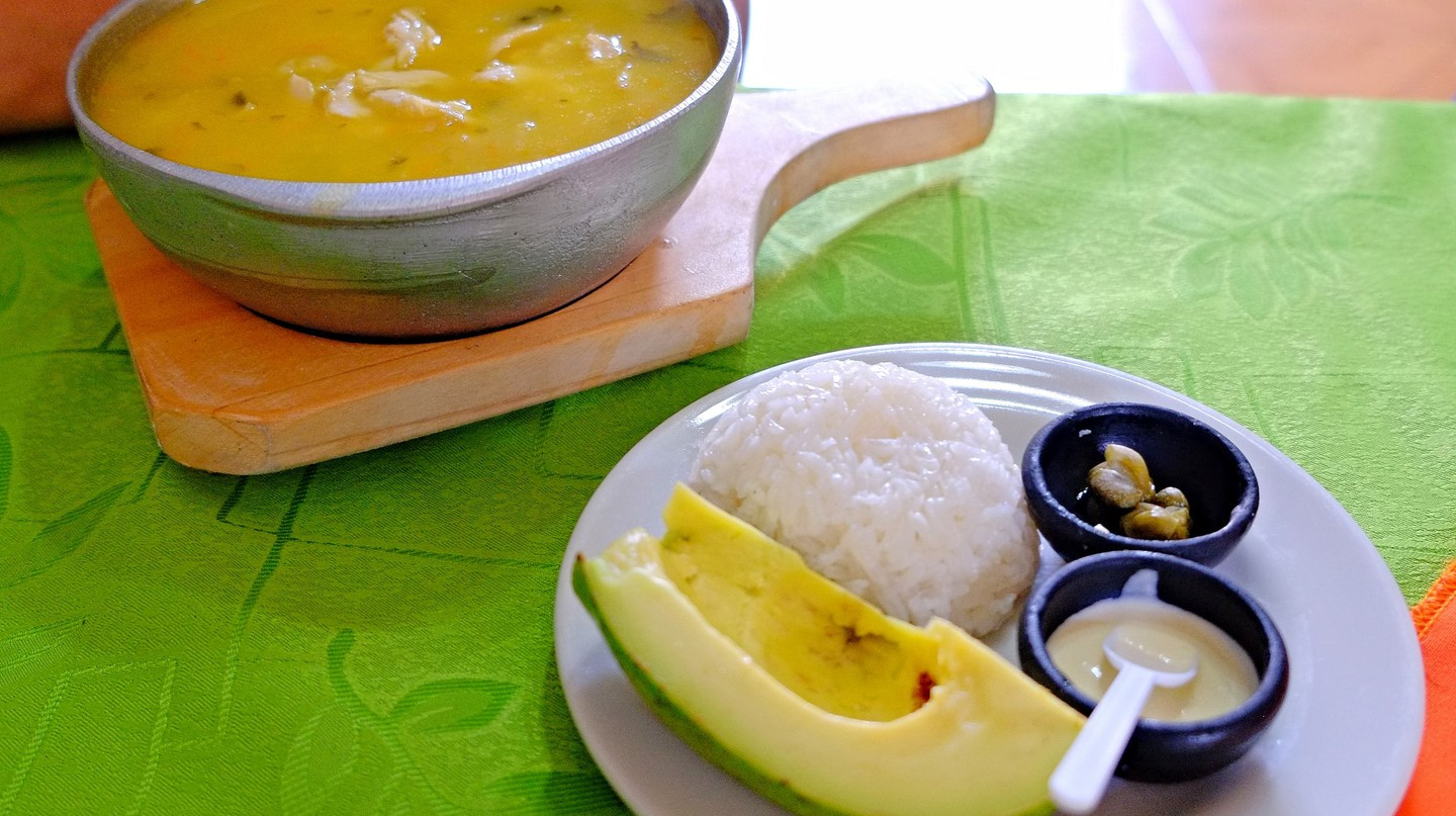 "<a href=""https://www.flickr.com/photos/61266278@N00/25952438801"" target=""_blank"" rel=""noopener noreferrer"">A full Colombian-style ajiaco with rice and avocado 
