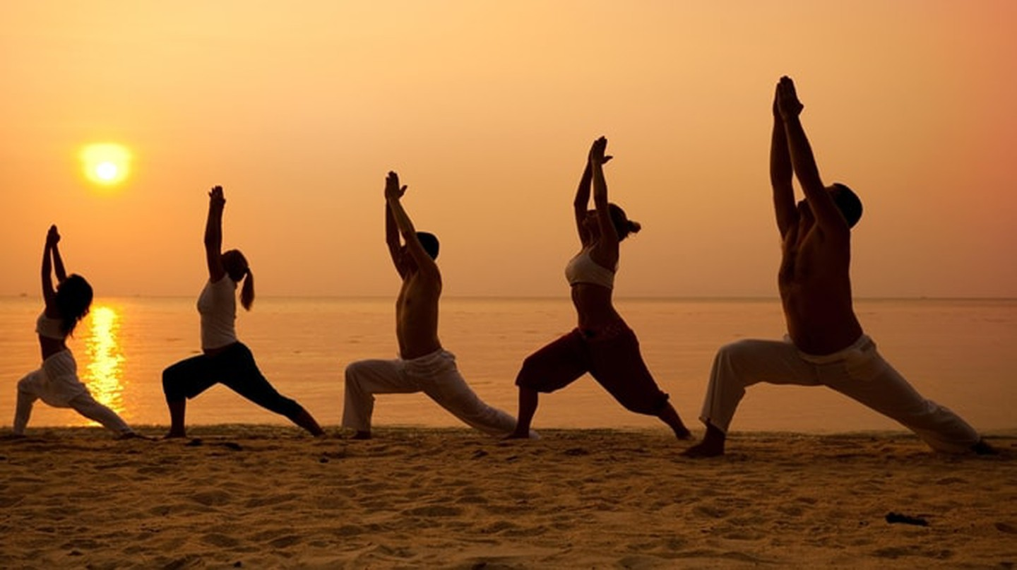 Beach yoga at sunset | Courtesy of Sailing Yoga Experience