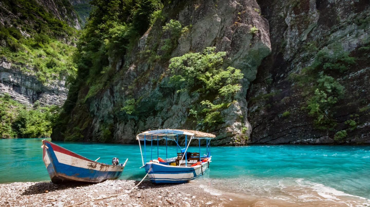 Take One of the Best Boat Trips of Your Life On Albania's Lake Koman