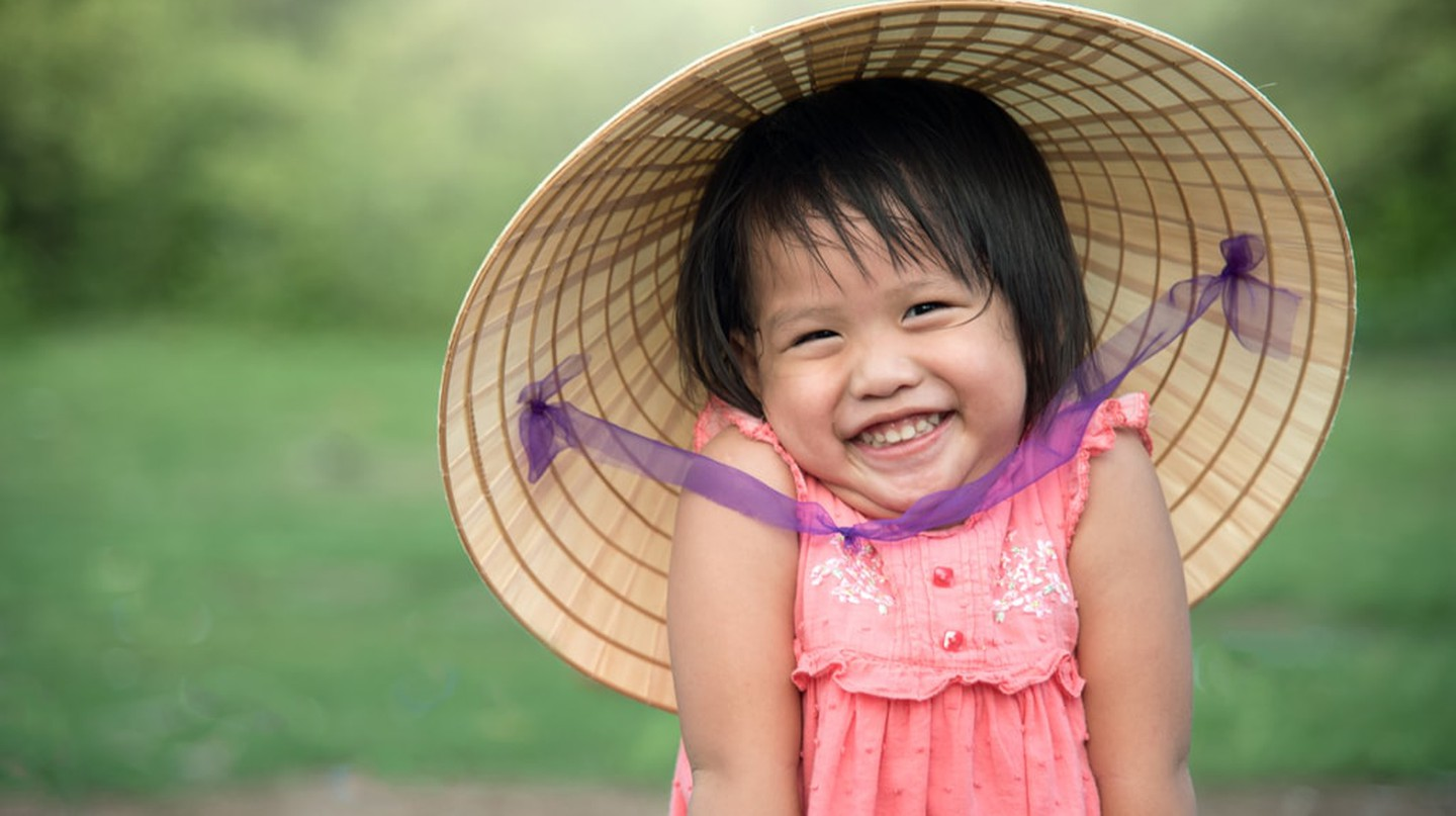 A young Vietnamese girl says hello | © CRStudio / Shutterstock