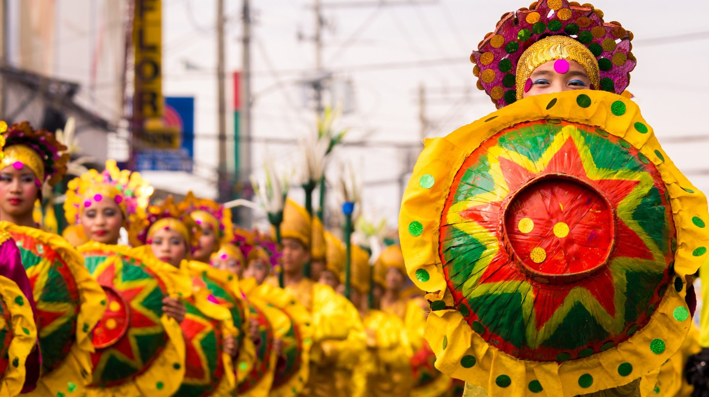 Dancers in costume at Kadayawan Festival, Philippines