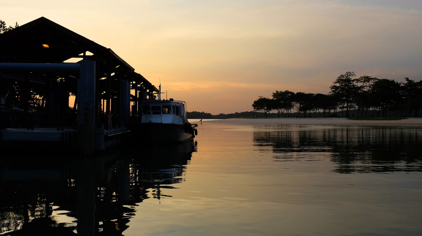 View of the sunset against the ferry terminal in Pulau Ubin