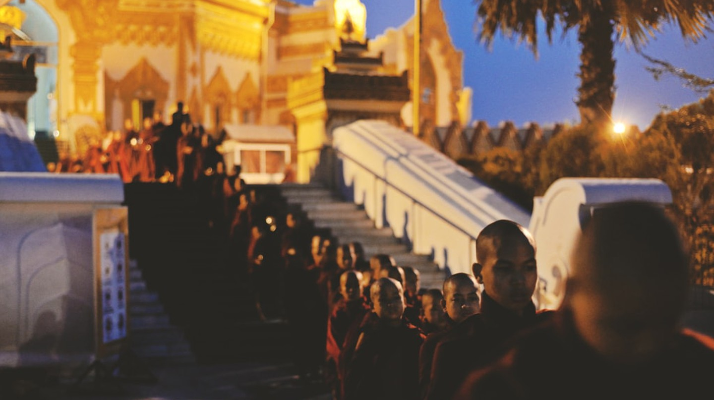 A line of monks at Swe Taw Myat Pagoda in Yangon, Myanmar | © Chase Chisholm