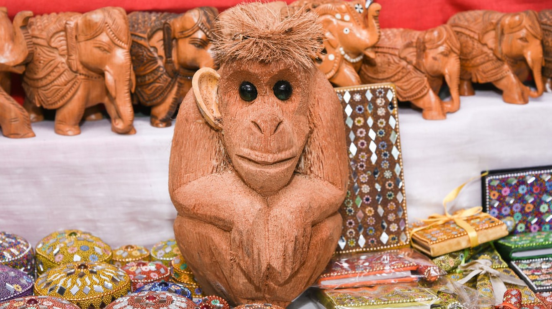 Statue monkey coconut sculpture ©  Santhosh Varghese/Shutterstock