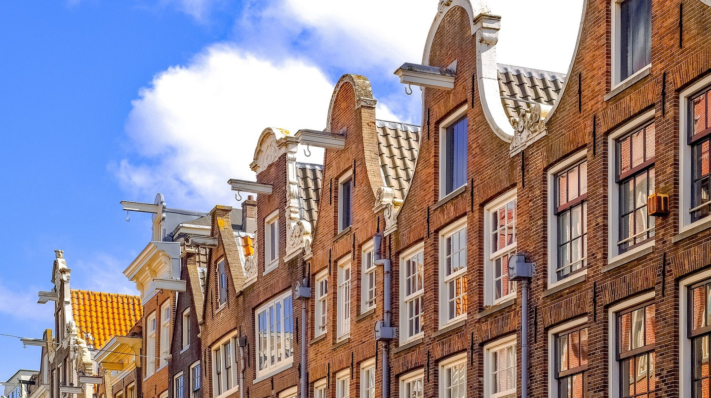 Why Do Houses and Buildings in Amsterdam Tilt Forward?