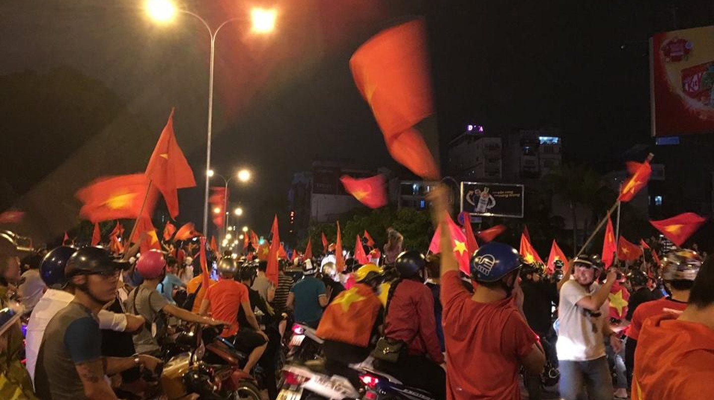 Vietnamese flags flying proudly | © Sasha Adams