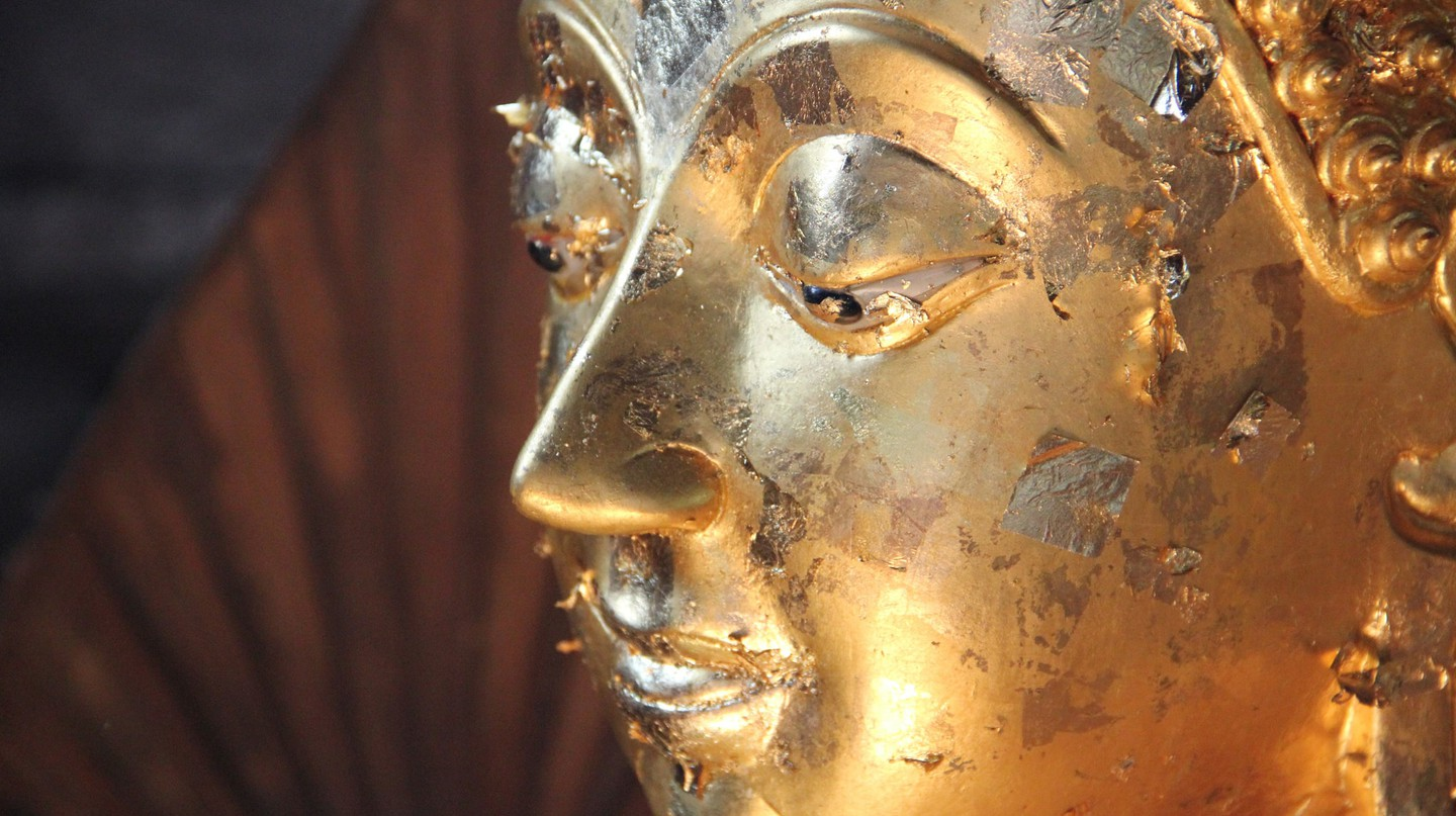 Close-up shot of a Buddha statue in Thailand | © Seba Della y Sole Bossio / Flickr