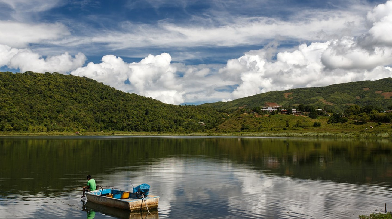 A lone boat on Rih Lake in Chin State, Myanmar | © Sam DCruz / Shutterstock