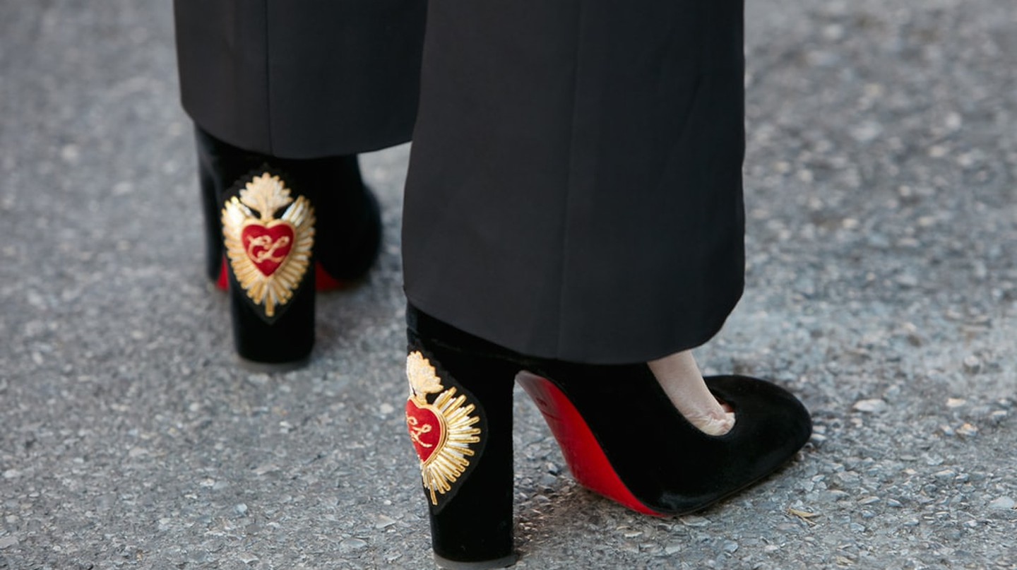Black velvet Louboutin heels spotted during Milan Fashion Week 2017 | Shutterstock/andersphoto