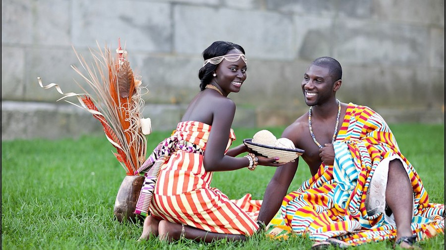 Bride and groom in kente slits