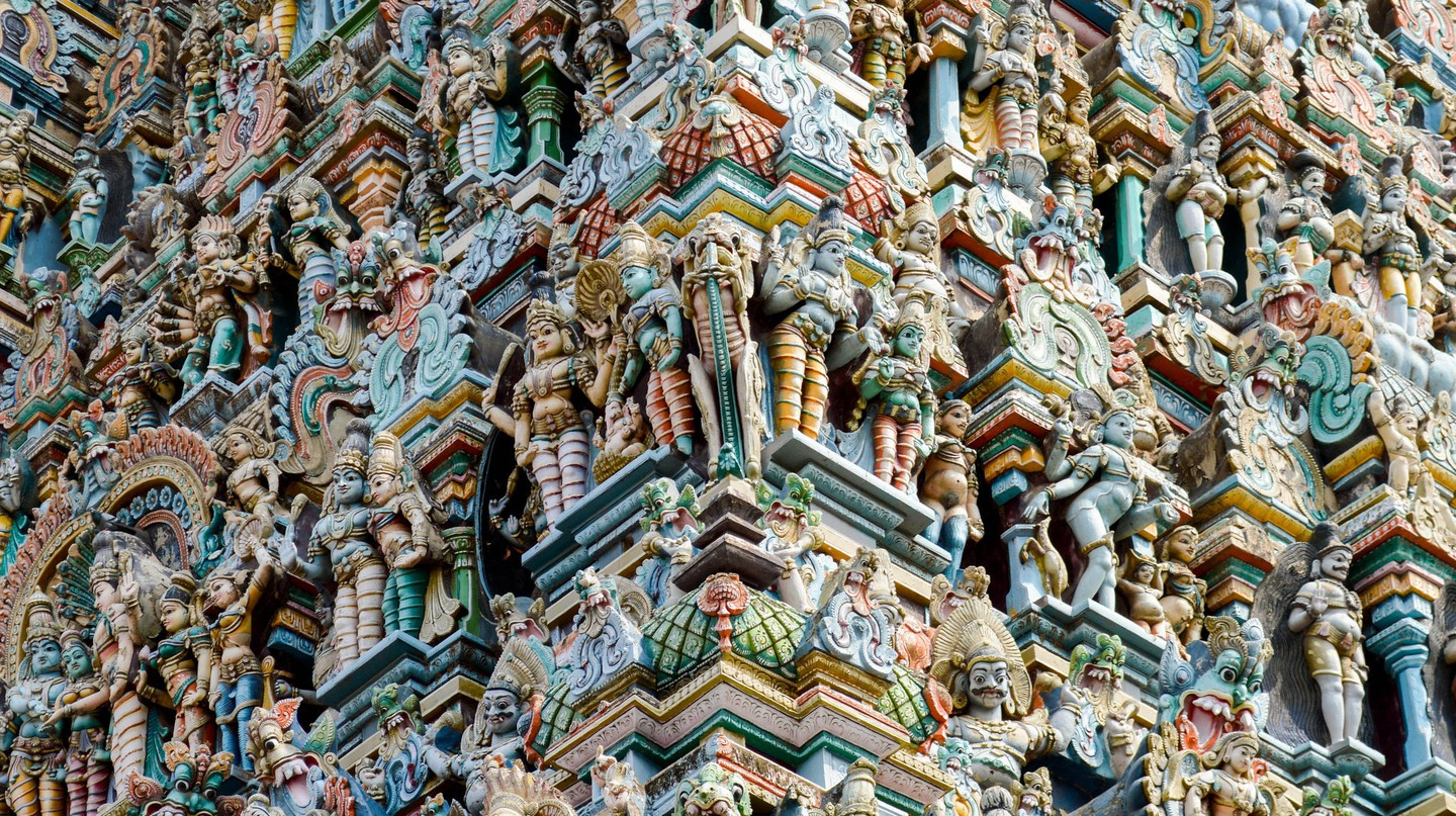 Elaborate carving on a gopuram or gateway tower of Madurai Meenakshi Temple