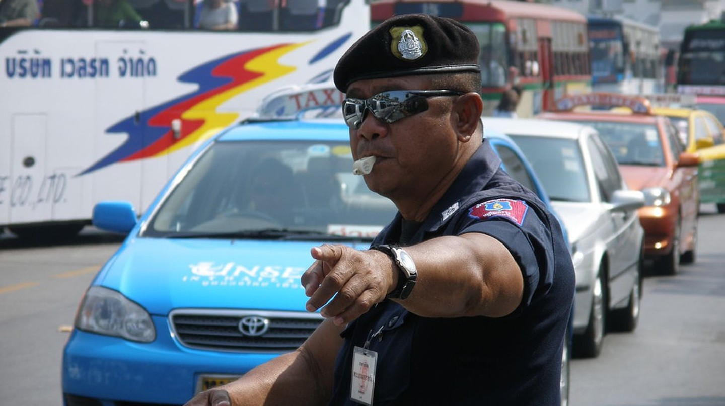 A Thai traffic policeman wearing sunglasses