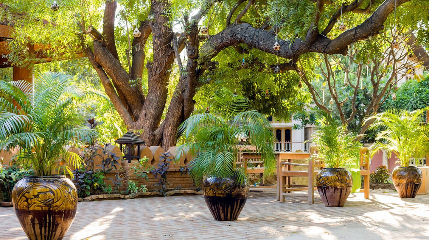 A welcoming garden awaits guests at 7 Sisters Restaurant in Bagan