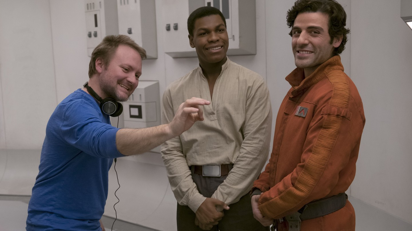 Star Wars: The Last Jedi: Director Rian Johnson on set with John Boyega (Finn) and Oscar Isaac (Poe Dameron).
