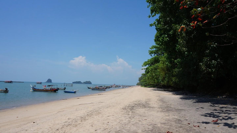 Fishermen boats near the shores of Black Sand Beach, Langkawi | © Sam Bedford