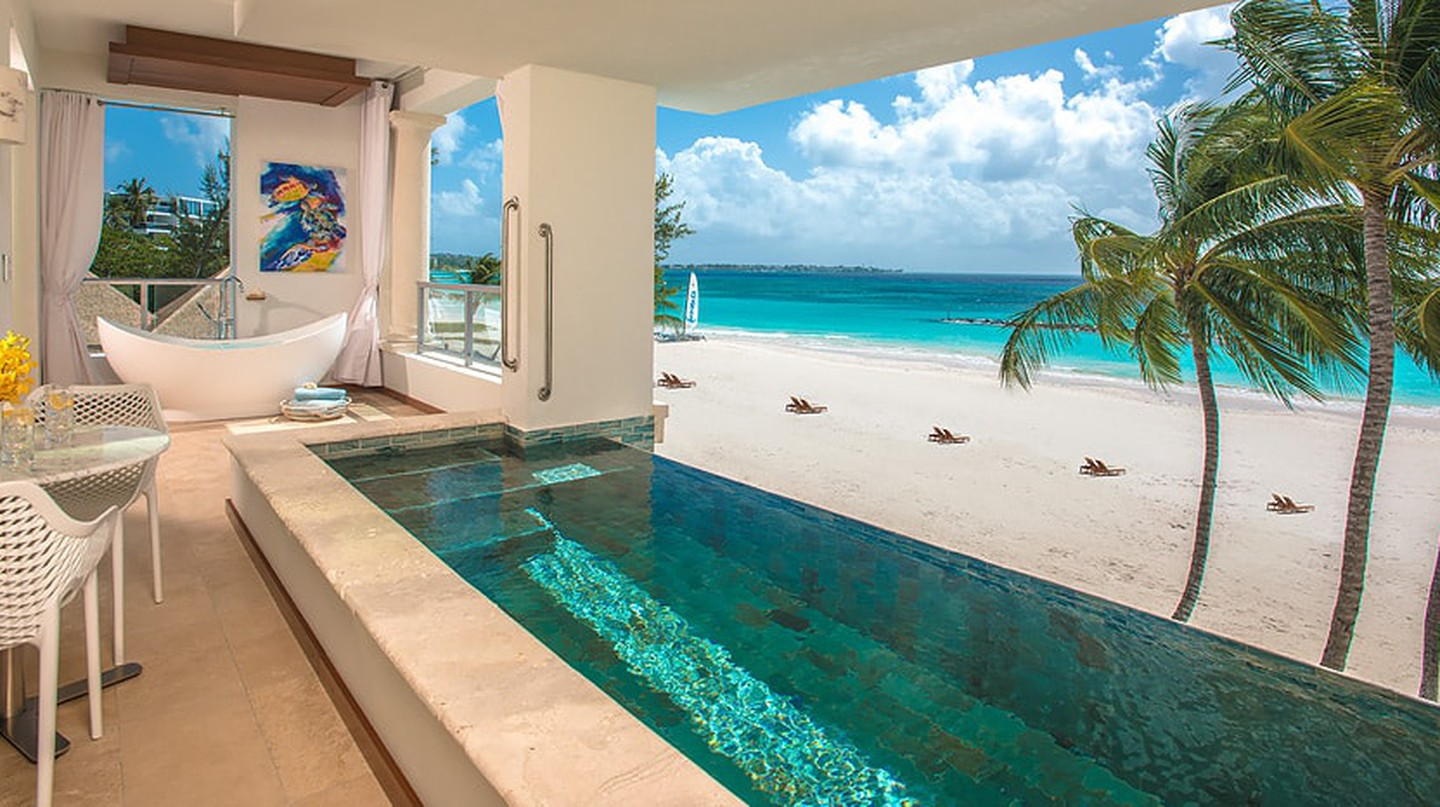 Enjoy beach views and your own private pool