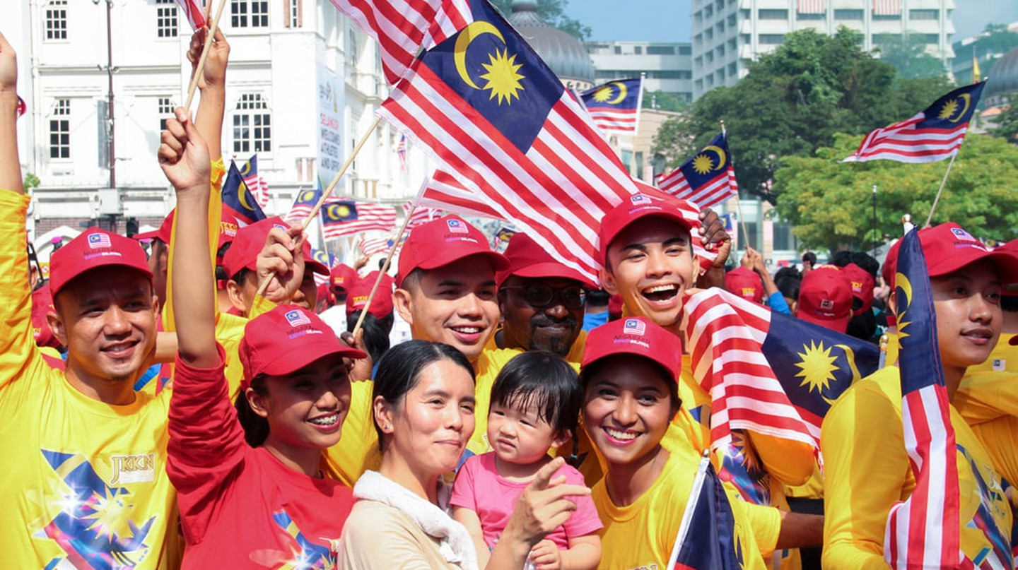 Patriotic volunteers celebrating their country indepence day at the iconic site Merdeka square, Kuala Lumpur, Malaysia   © Calvin Chan/Shutterstock