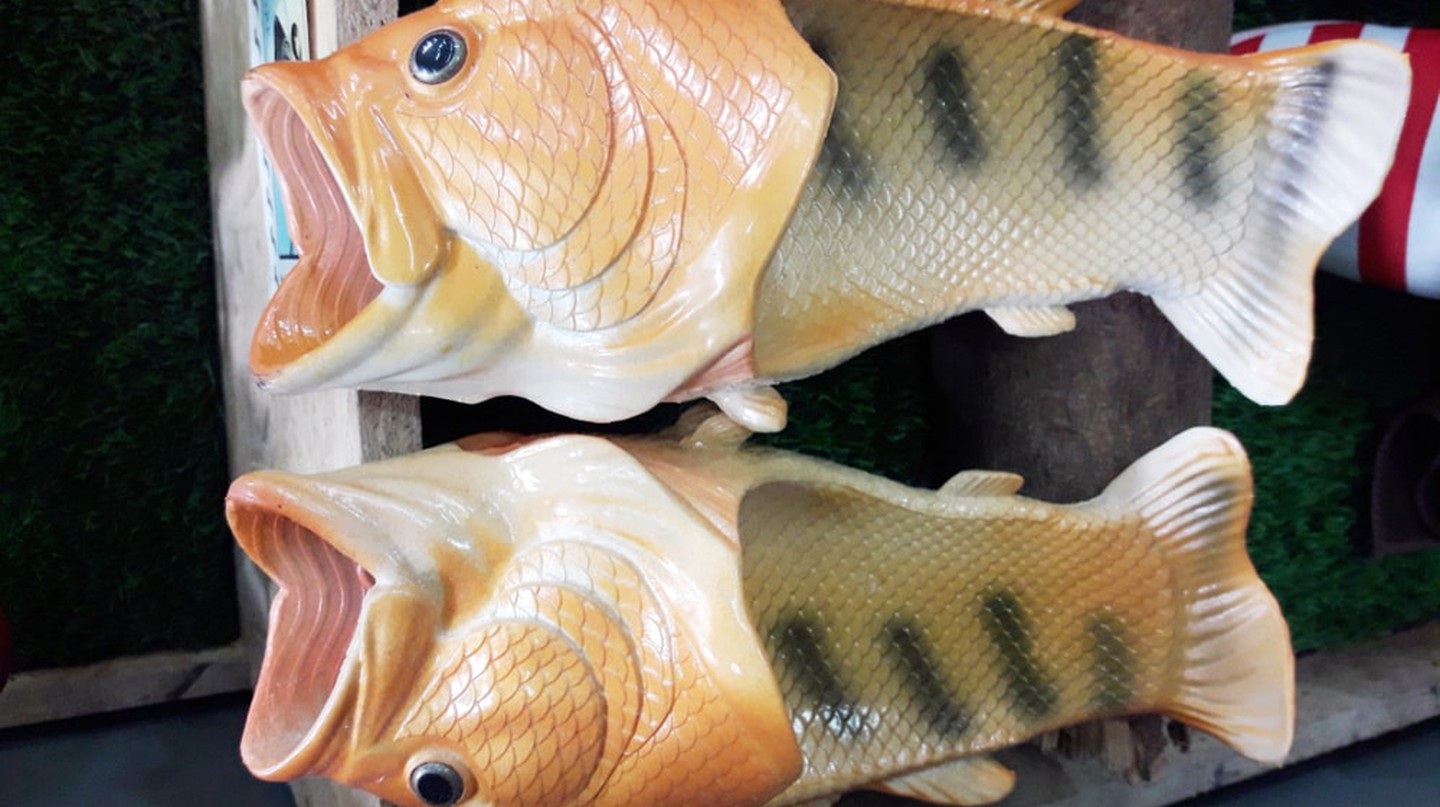 Bizarre fish slippers with gaping mouths