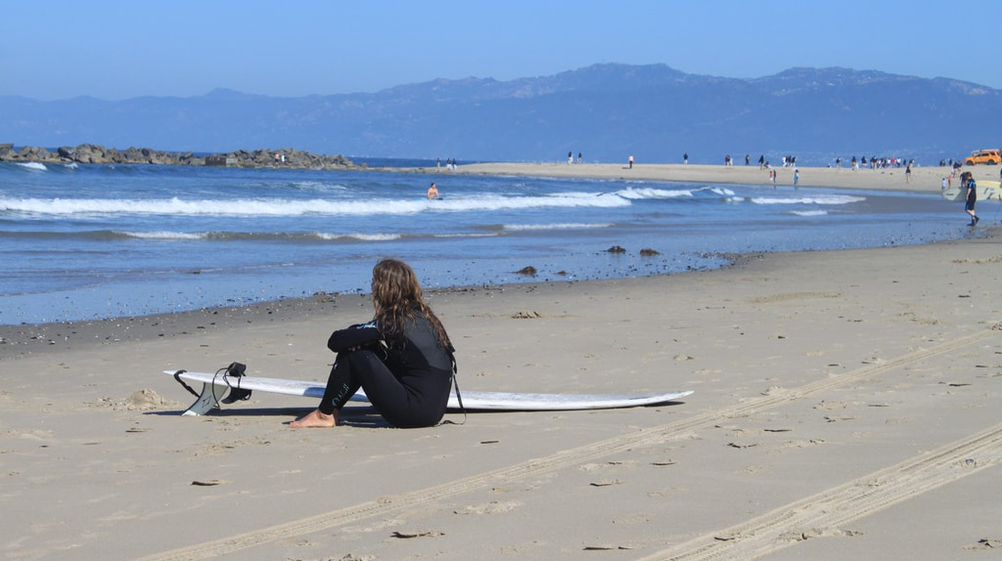 A surfer girl contemplates