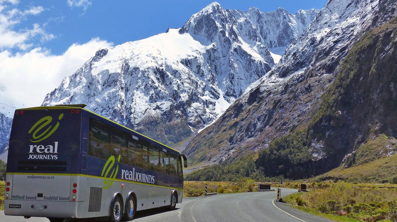 A tour bus heading towards Hollyford Valley