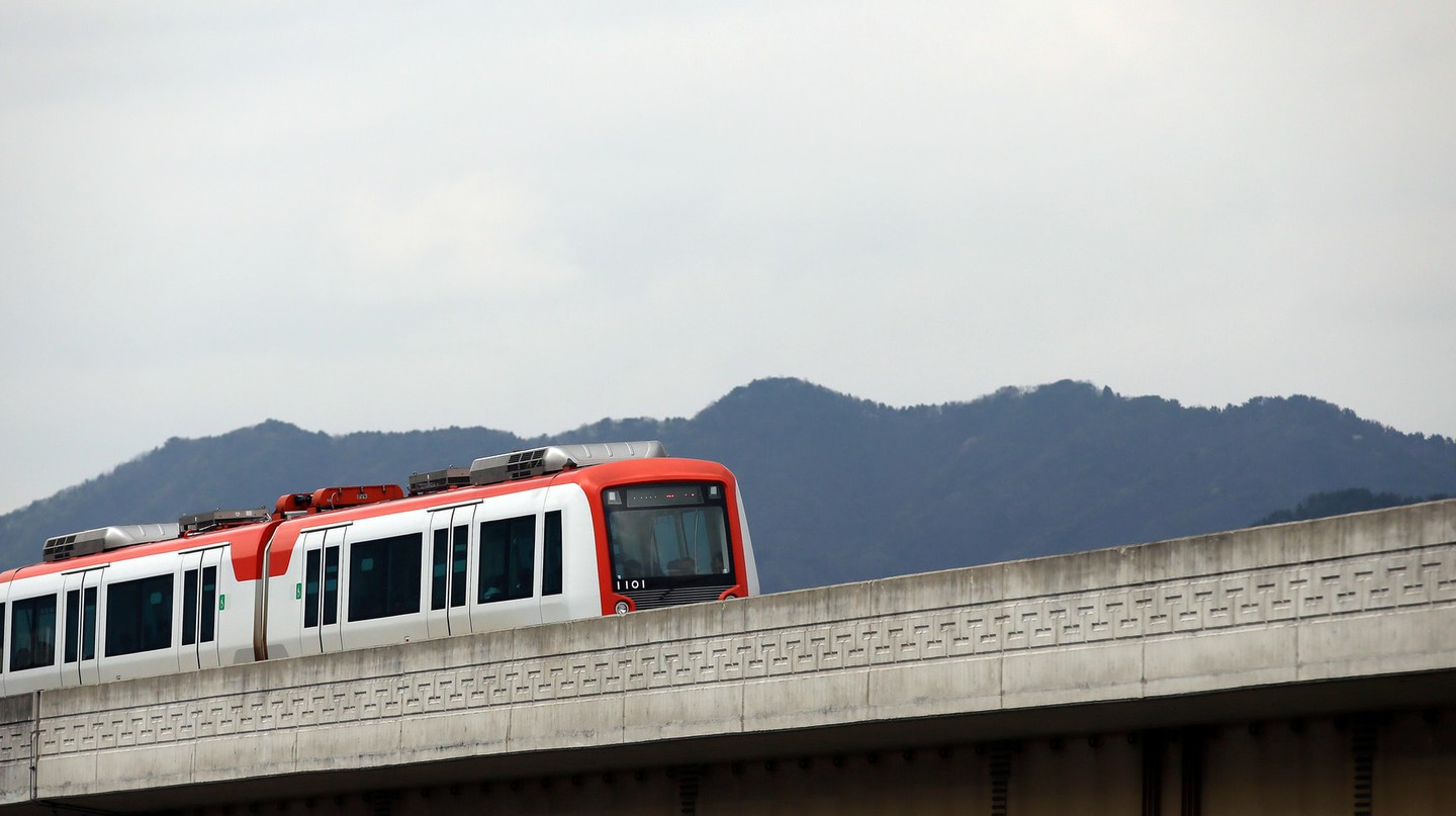 A train heads along the Gimhae Light Rail tracks