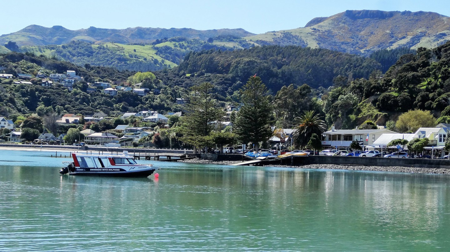Harbour cruise boat arriving in Akaroa