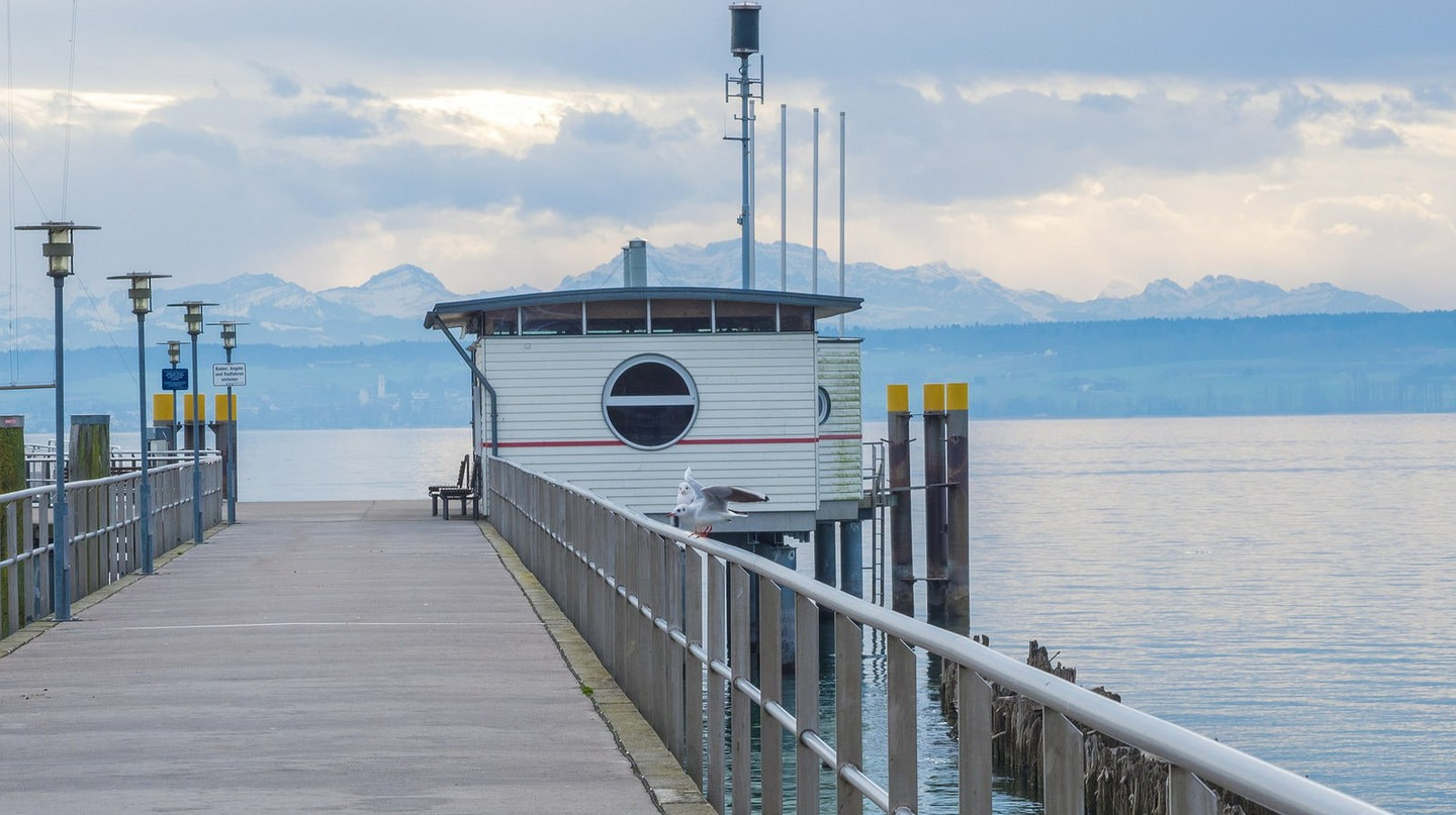 A ferry port on Lake Constance with the majestic Alps in the background