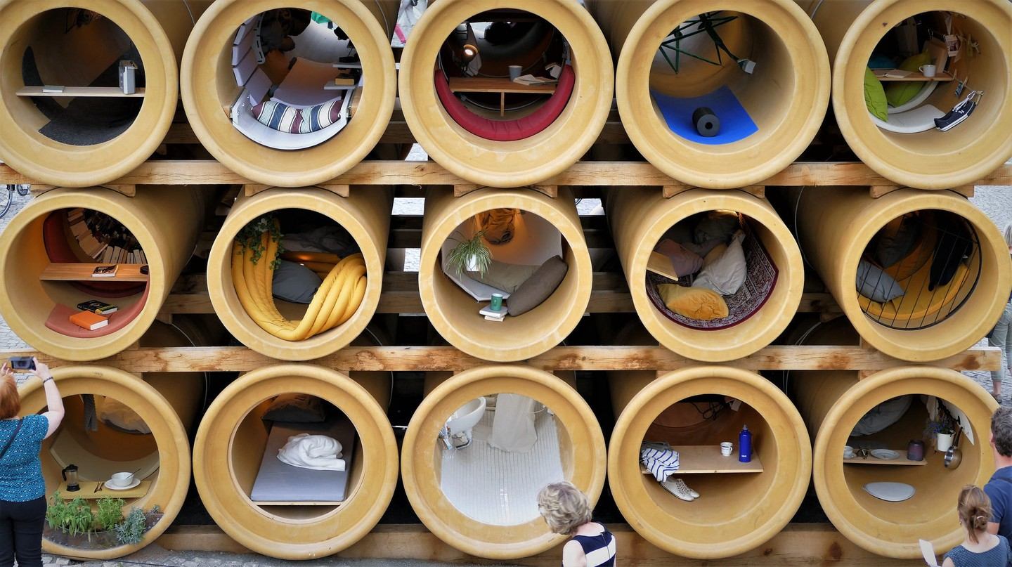 Refugee homes in tubes art installation