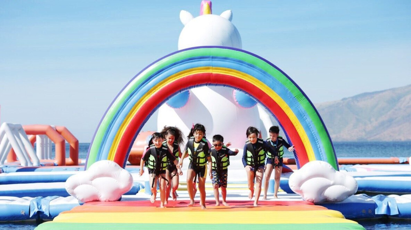 Kids running across rainbow walk at Unicorn Island