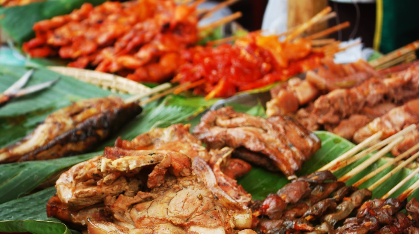 Barbecue and meat on display at a street food stall during the Dinagyang Festival in Iloilo City, Philippines