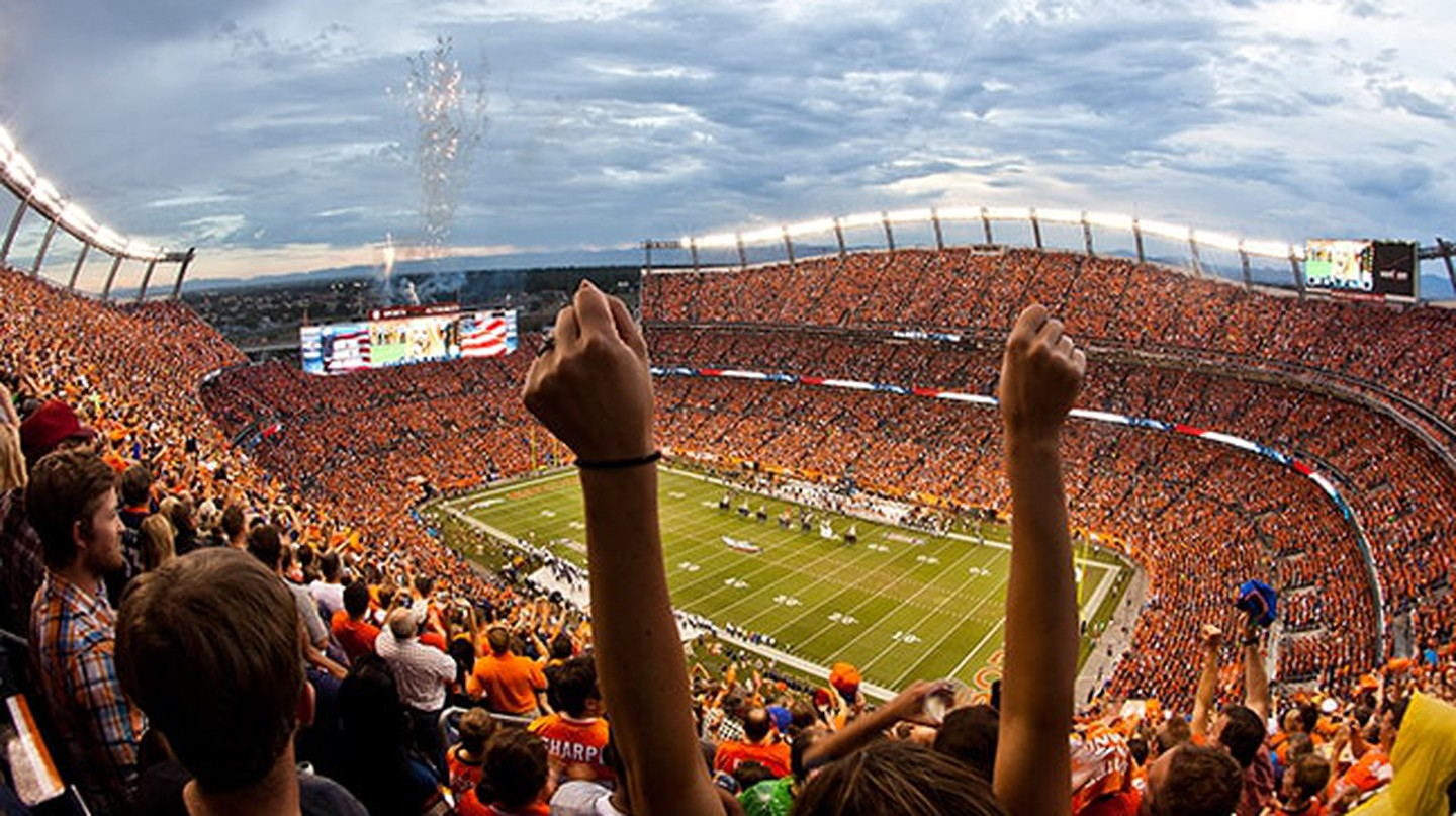 Denver Broncos fans cheer during a game