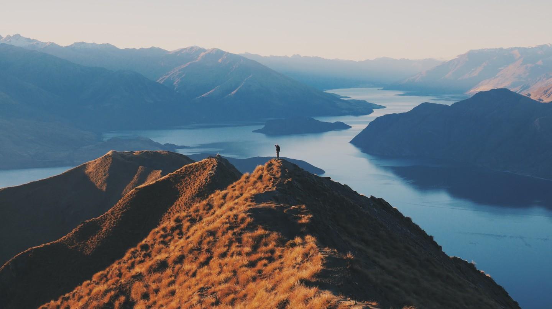 A visitor exploring Roys Peak, New Zealand